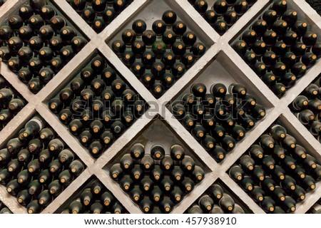 Many dusty wine bottles are on the shelves,Racks of wine bottles - stock photo