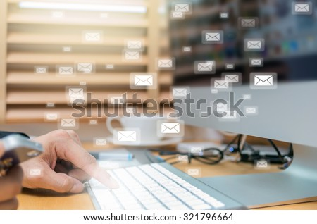 Many e-mail over the finger pressing the computer keyboard blurred background, business technology concept - stock photo