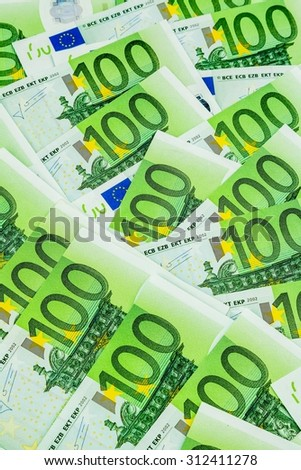 many einhhundert euro banknotes are adjacent. symbolic photo for wealth and investment - stock photo