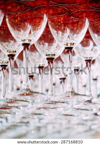 Many empty glasses for a wine drying in the bar. Close up photo with selective focus