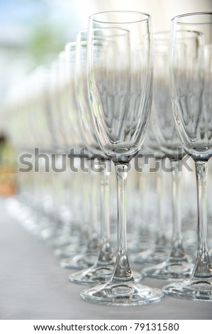 Many empty glasses in a line - stock photo