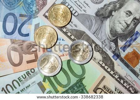 Many euro and dollar banknotes and coins- closeup shot - stock photo