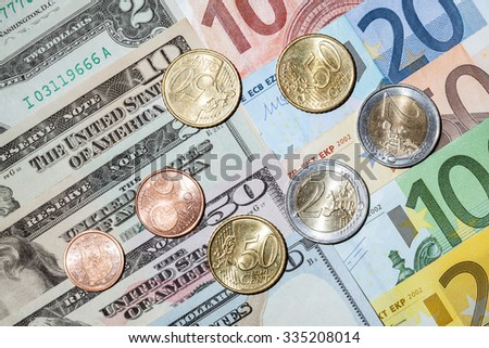 Many euro and dollar banknotes and euro coins- closeup shot