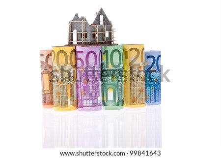 many euro bank notes with shell building