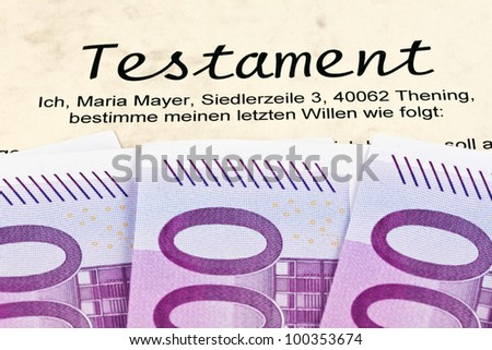 many euro banknotes and testament in german - stock photo