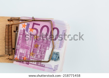 many euro banknotes in a mousetrap. symbol photo for debt and debt for loans. - stock photo