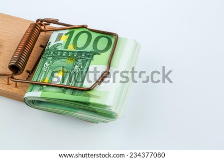 many euro banknotes in a mousetrap. symbolic photo for debt and debt in loans. - stock photo