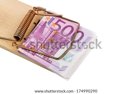 many euro banknotes in a mousetrap. symbolic photo for debt and debt with loans. - stock photo