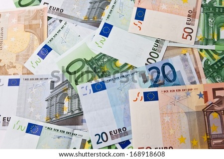 Many euro banknotes making european currency background - stock photo