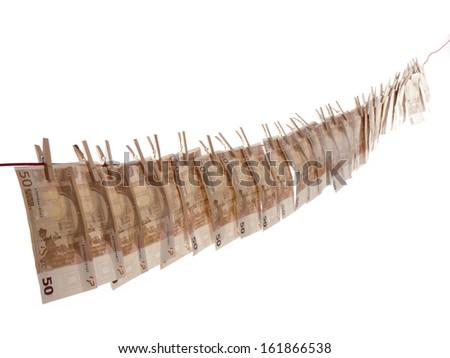 many euro banknotes on a clothesline - stock photo