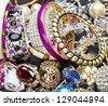 Many fashionable women's jewelry. Brilliant bangles - stock photo