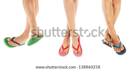 Many feet in colorful summer flip flops - stock photo