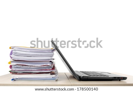 Many files and a computer on a desk isolated on white background - stock photo