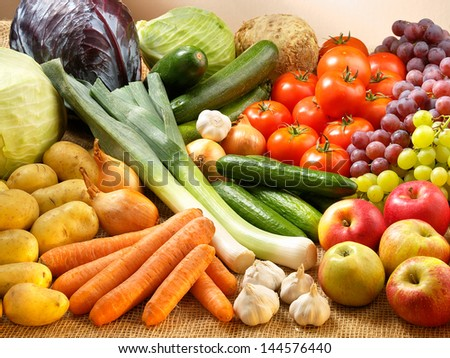 Many fresh fruits and vegetables on sack - stock photo