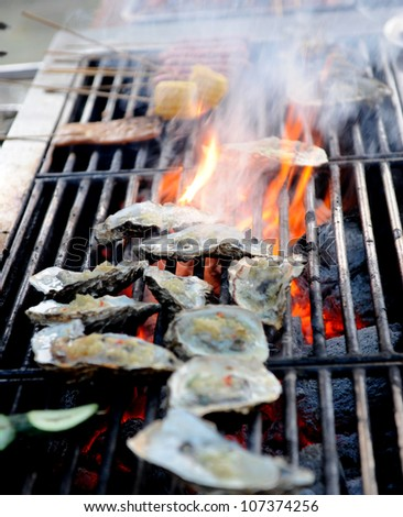 many fresh oyster on fire.