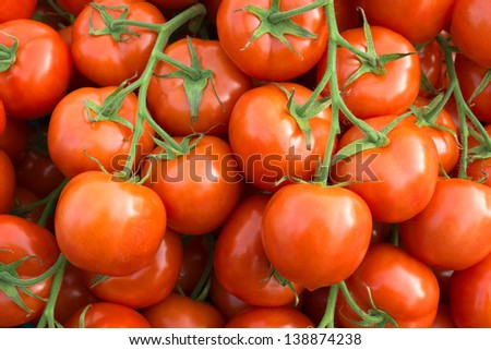 Many fresh tomatoes on the street market.