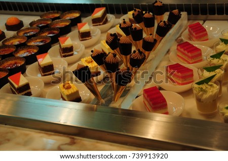 https://thumb1.shutterstock.com/display_pic_with_logo/167494286/739913920/stock-photo-many-fruit-desserts-739913920.jpg