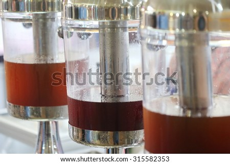 many fruit juice and tea in cold tank in restaurant, background of drink water for good health