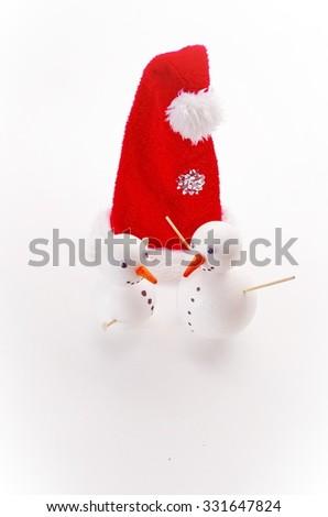 many funny selfmade snowmen isolated on white background - stock photo