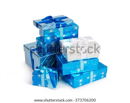 Many gift boxes different sizes with ribbon bows in composition isolated on white - stock photo