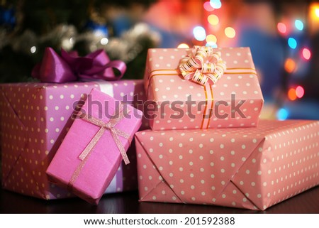 Many gifts on bright background - stock photo