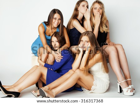 many girlfriends hugging celebration on white background, smiling talking chat, girl next door close up - stock photo