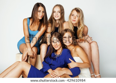 many girlfriends hugging celebration on white background, smiling talking chat, girl next door close up wondering sweety group - stock photo