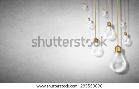 Many glass light bulbs hanging from above - stock photo