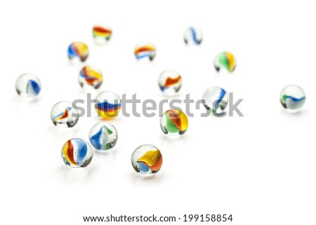 Many glass marbles isolated on white background