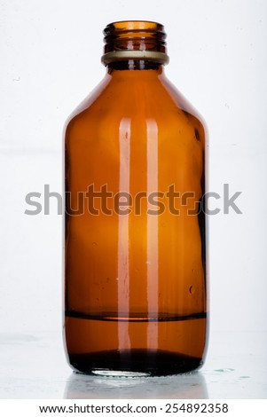 Many glass medicine bottles with color water - stock photo
