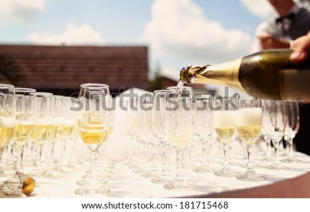 Many glasses of champagne on table - stock photo