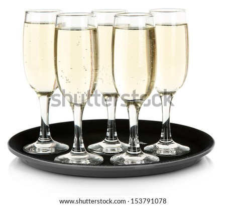 Many glasses of champagne on the tray, isolated on white