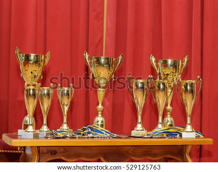 Many golden award cups waiting for their winners