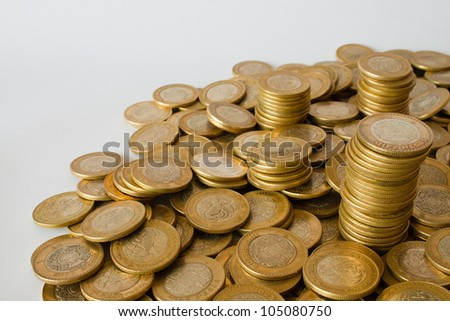 many golden coins background, mexican ten pesos money - stock photo