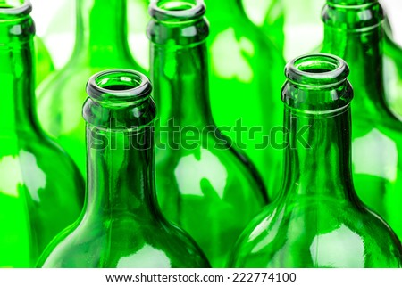 Many green bottles in a row - stock photo