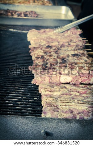 Many grilling chicken shish kababs at barbecue restaurant kitchen - stock photo