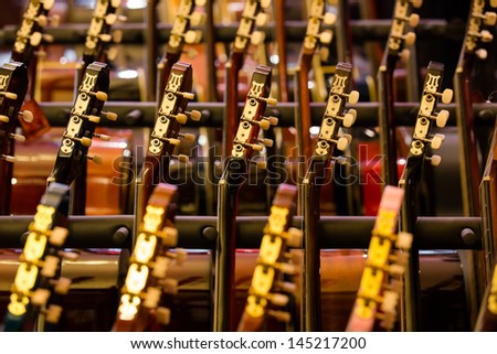 many guitars presented in a row - stock photo