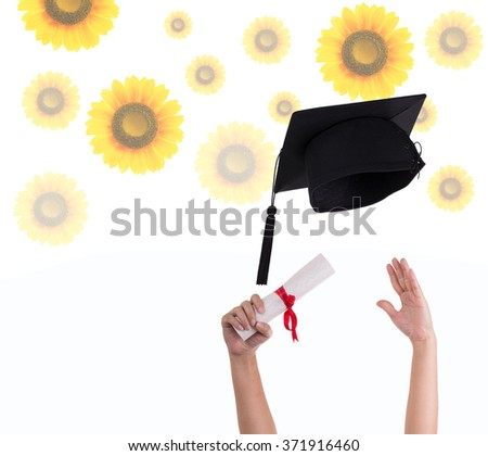 Many hand holding graduation hats on background of  flowers.  - stock photo