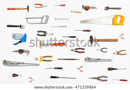 many hand tools arranged on white background