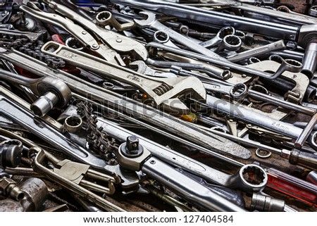 Many hand tools in car garage - stock photo