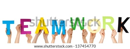 many hands hold the word TEAMWORK, isolated - stock photo