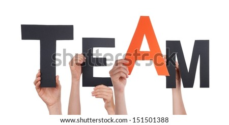 Many Hands Holding a Black and Orange Team, Isolated - stock photo