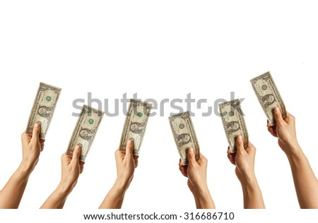 many hands holding a dollar banknote isolated