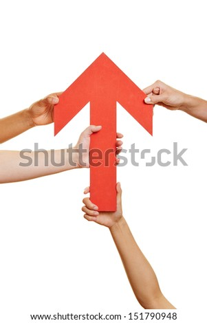 Many hands holding a red arrow pointing up - stock photo