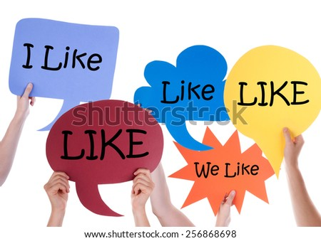 Many Hands Holding Colorful Speech Balloons Or Speech Bubbles With English Word Like Isolated On White - stock photo