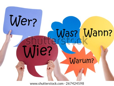 Many Hands Holding Colorful Speech Balloons Or Speech Bubbles With German Questions Wer Wie Was Warum Wann Means Who How What Why When Isolated On White - stock photo