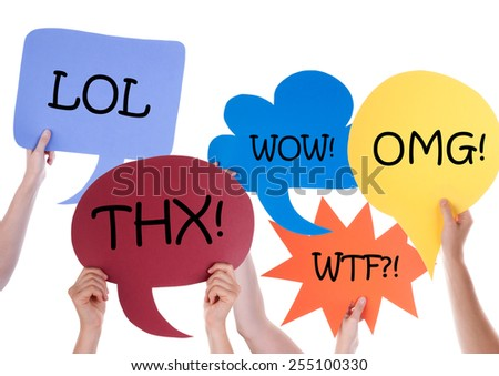 Many Hands Holding Colorful Speech Balloons Or Speech Bubbles With Lol Wow Omg Thx Wtf Isolated On White - stock photo
