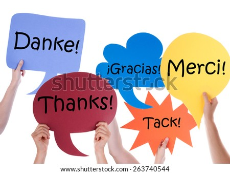 Many Hands Holding Colorful Speech Balloons Or Speech Bubbles With Thank You In Different Languages Like Isolated On White - stock photo
