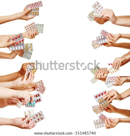 Many hands holding different drugs and pills from both sides - stock photo