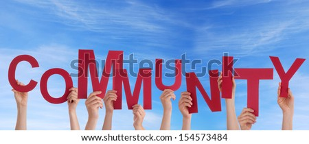 Many Hands Holding the Red Word Community in the Sky - stock photo